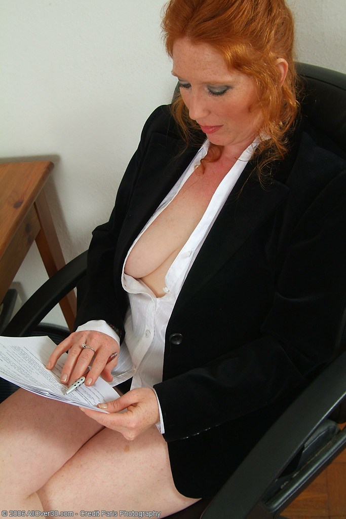 Redheaded Rose Plays Around with Her  Bushy  Cunt at the Office