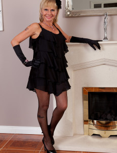 Blond 42 Year Old Cath Oakley Glides off Her Ebony Thong and Poses