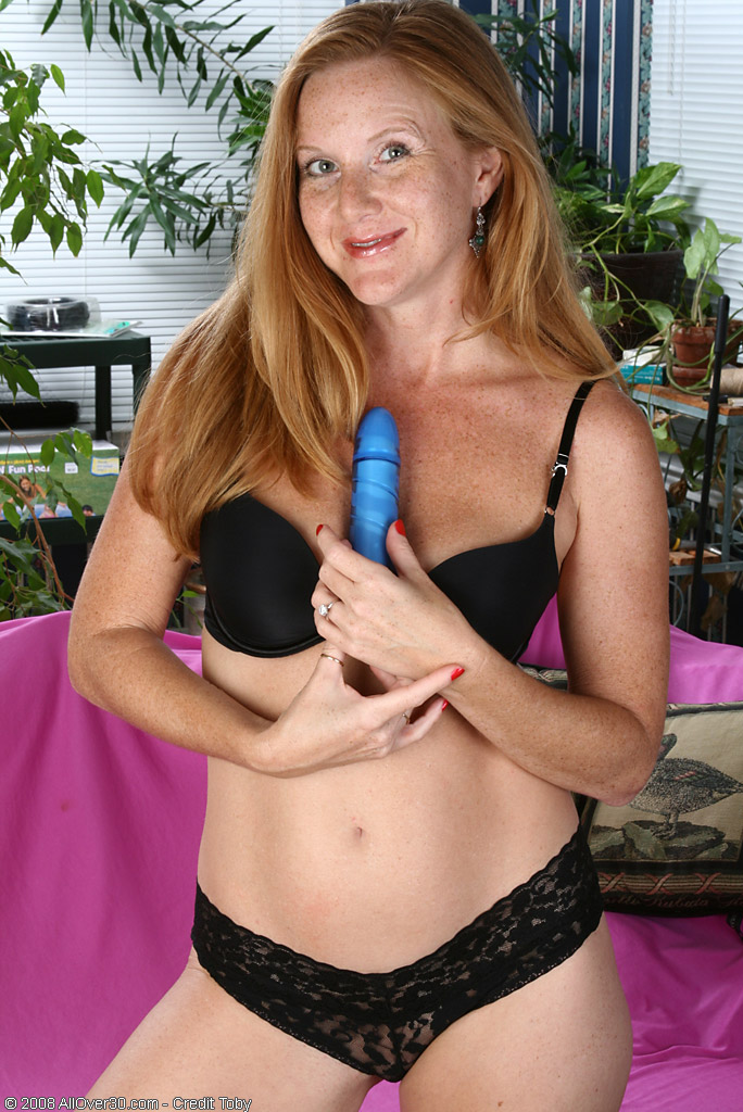 Redheaded  Older Chick Plunges a Blue Dildo Up Her  Bald  Honeypot