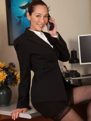 34 Year Old Cool Executive Fiona Filmore Opens Her Gams on the Desk