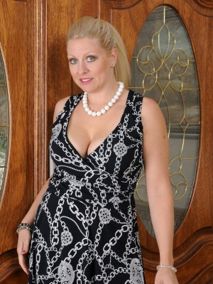 36 Yr Old Zoey Tyler Removes Her Elegant Dress Showcasing Down the Girl Pink